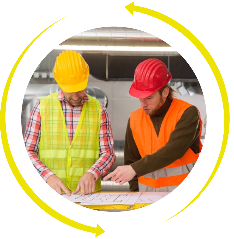Two construction workers in hardhats looking at plans